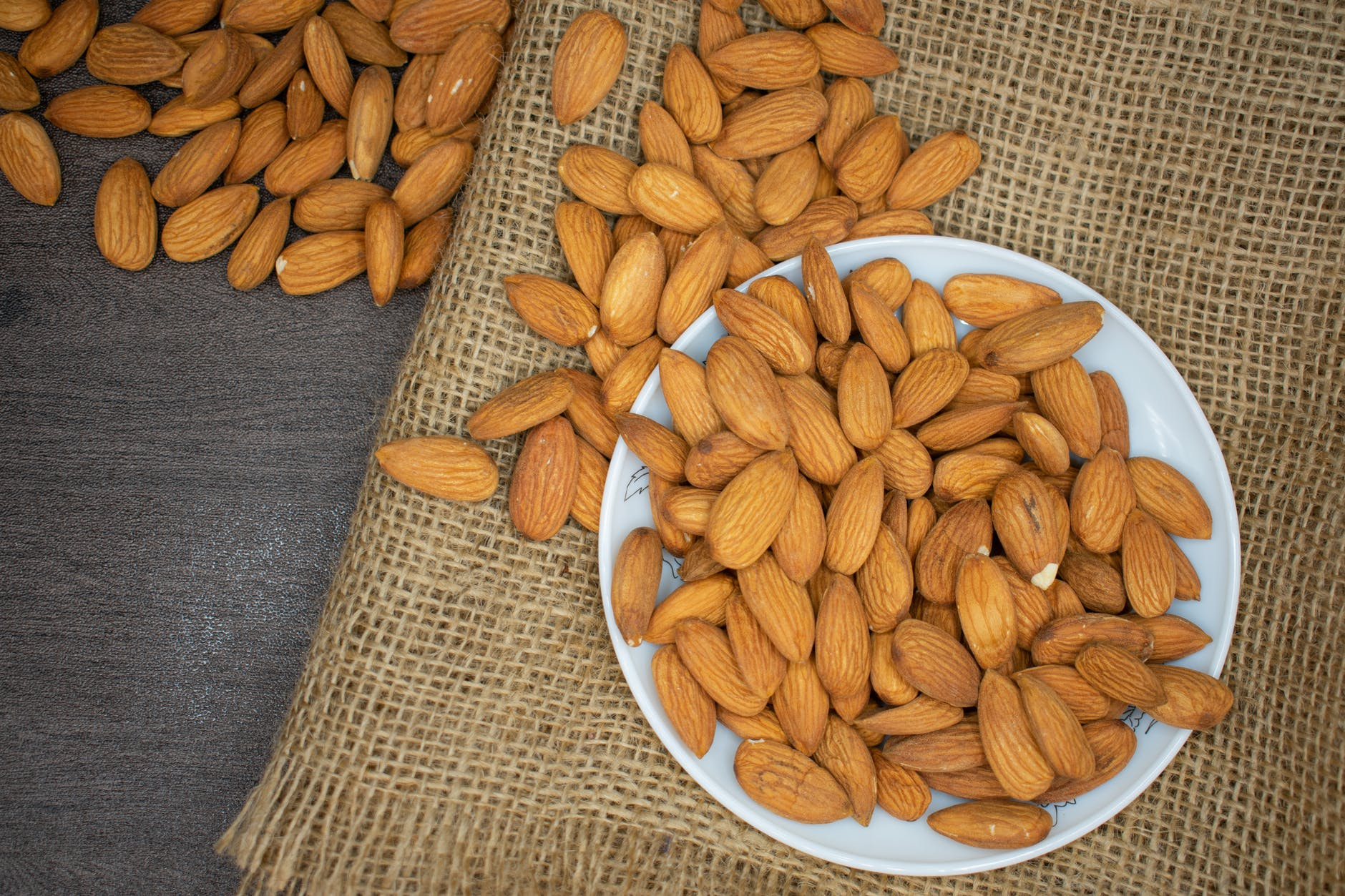 brown almond nuts on white plate